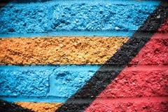 Предпосылка кирпичной стены голубого красного цвета оранжевая черная желтая Стоковые Фотографии RF