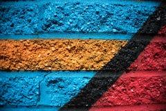 Предпосылка кирпичной стены голубого красного цвета оранжевая черная желтая Стоковая Фотография RF