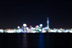 Предпосылка конспекта городского пейзажа ночи, запачканное bokeh фото Стоковые Фотографии RF
