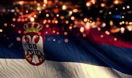 Предпосылка конспекта Bokeh ночи света национального флага Сербии Стоковое Изображение RF