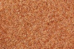 Предпосылка коричневого льняного семени Стоковые Фотографии RF