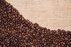 Предпосылка кофейного зерна с тканью реднины Стоковое Фото