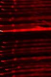 Предпосылка красного СИД освещает с влиянием bokeh Стоковые Фото