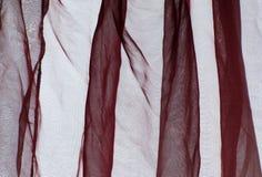 Предпосылка красного цвета Бордо занавеса маркизета Стоковое Фото