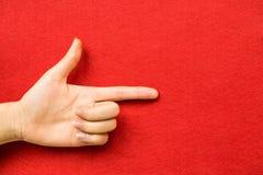 Предпосылка красного цвета пункта пальца Стоковые Изображения