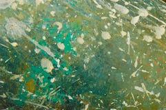 Предпосылка крупного плана грубой поверхности в покрашенных пятнах Стоковое Изображение