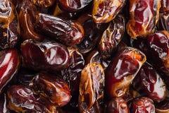 Предпосылка крупного плана плодоовощ даты Куча высушенного сияющего коричневого красного плодоовощ даты Стоковое Изображение