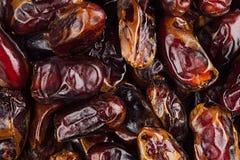 Предпосылка крупного плана плодоовощ даты Куча высушенного сияющего коричневого красного плодоовощ даты Стоковое Изображение RF