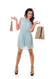 предпосылка кладет полным белизну в мешки покупкы длины девушки изолированную удерживанием Стоковая Фотография RF