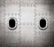 Предпосылка металла окна корабля или подводной лодки стоковое изображение