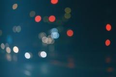 Предпосылка ночи из фокуса на голубой предпосылке Стоковое Изображение
