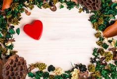 Предпосылка дня валентинок с зеленым коричневым цветом высушила заводы Стоковое Фото