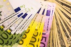 Предпосылка от банкнот доллара и евро различных Стоковая Фотография RF