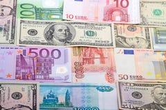 Предпосылка от банкнот различных валют Стоковые Изображения