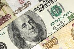 Предпосылка от долларов и рублей Стоковые Фото