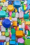 Предпосылка от пластичных изделий - бутылок, ведер, банок, коробки Стоковые Изображения