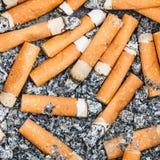 Предпосылка от stubs и золы сигареты Стоковое Фото