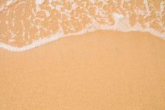 Предпосылка песка пляжа Граница волны и песка Стоковые Фото