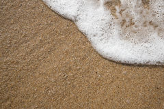 Предпосылка песка с волной Красивые предпосылка песка и волна fr Стоковое фото RF