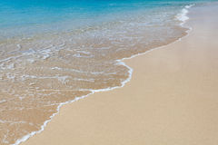 Предпосылка песка с волной Стоковое фото RF