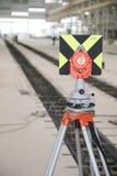 Предпосылка поднимающих вверх измеряющего прибора близкая и фабрики как вертикаль Стоковое Фото