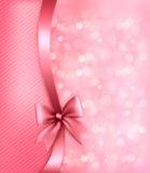 Предпосылка праздника розовая с смычком и тесемкой подарка. Стоковые Фотографии RF
