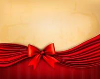Предпосылка праздника с старой бумагой и красный подарок обхватывают Стоковое Изображение RF