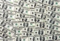 предпосылка представляет счет многочисленнnNs рамки долларов польностью положенное Стоковая Фотография RF