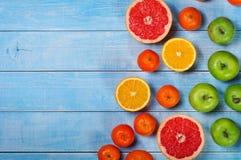 Предпосылка плодоовощ - грейпфрут, яблоки, апельсины и tangerines Стоковое фото RF