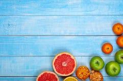 Предпосылка плодоовощ - грейпфрут, яблоки, апельсины и tangerines Стоковые Изображения
