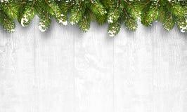 Предпосылка рождества деревянная с ветвями ели Стоковая Фотография RF