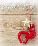 Предпосылка рождества ковбоя с западным ботинком игрушки и звезда на wo Стоковая Фотография RF