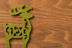 Предпосылка рождества с зеленым северным оленем Стоковые Изображения RF