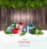 Предпосылка рождества с подарочными коробками и ветвями дерева Стоковые Фото
