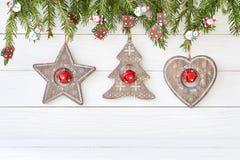 Предпосылка рождества с сердцем, звездой, рождественской елкой скопируйте космос Стоковая Фотография RF