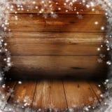 Предпосылка рождества с снегом и света на старых досках Стоковое Фото