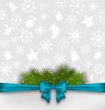 Предпосылка рождества с хворостинами ленты и ели смычка Стоковые Фотографии RF