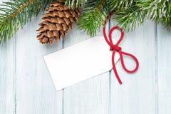 Предпосылка рождества с ярлыком и деревом Стоковая Фотография