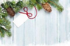 Предпосылка рождества с ярлыком подарка Стоковое Изображение