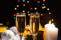 Предпосылка рождества шампанского света горящей свечи Стоковые Изображения RF