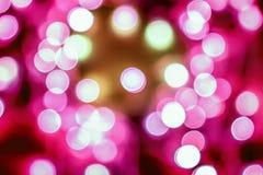 Предпосылка розового праздничного рождества элегантная абстрактная с bokeh освещает Стоковое Изображение RF