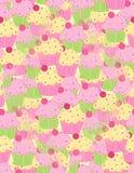 Предпосылка розовых желтых пирожных безшовная Стоковое фото RF