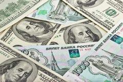 Предпосылка русских рублей и долларов США Стоковые Фото