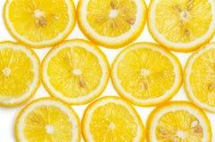 Предпосылка свежих желтых кусков лимона Стоковое Изображение RF