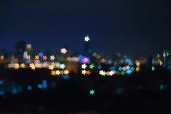 Предпосылка света ночи формы звезды Bokeh стоковое изображение rf