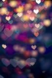 Предпосылка сердца bokeh Defocus фильтрованная светом Стоковая Фотография RF