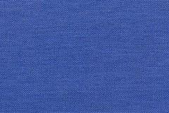 Предпосылка сини военно-морского флота от материала ткани с плетеной картиной, крупным планом Стоковое Фото