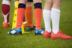 Предпосылка спорта Футбольная команда; футбольная команда; носки футбола и s стоковое фото