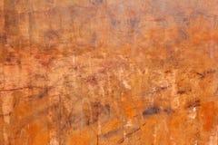Предпосылка стены оранжевого красного цвета Grunge Стоковые Изображения
