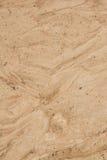 Предпосылка сухой аграрной коричневой детали почвы естественная Стоковое Фото